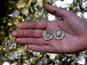 New one pound coins are displayed The Royal Mint