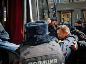 Alexei Navalny is arrested during a rally in Moscow