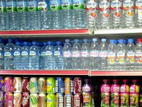 Bottles of soft drinks on a shop shelf. File pic