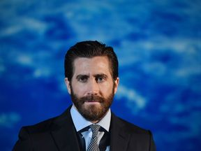 US actor Jake Gyllenhaal poses during a photocall for his new film 'Life'