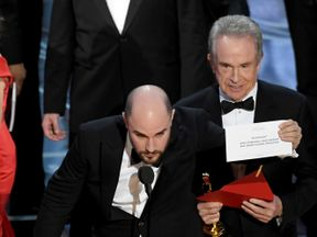 La La Land producer Jordan Horowitz holds up Moonlight as the best picture winner