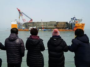 Relatives of the missing victims look at the Sewol ferry