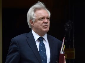 Britain's Secretary of State for Exiting the European Union David Davis arrives in Downing Street