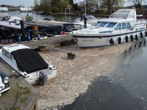 Sewage foam collecting around boats at Bourne End Marina