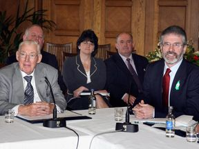 DUP leader Ian Paisley and Sinn Fein leader Gerry on 26 March 2007.  Arlene Foster is sat behind.