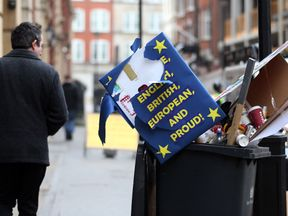 Placards extolling the virtues of remaining in the EU lie in a bin after a pro-EU march at the weekend