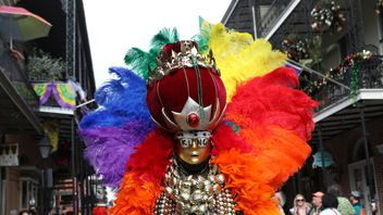 People celebrate Mardi Gras at the French Quarter in New Orleans, Louisiana