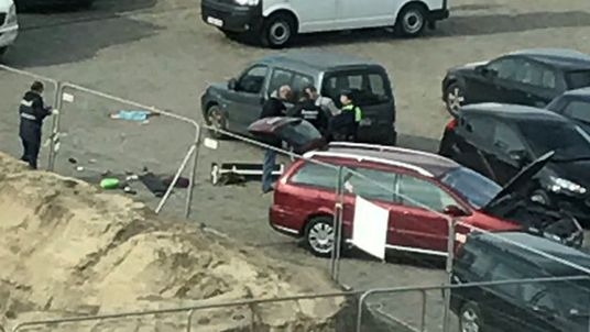 Police officers next to the car used in the incident