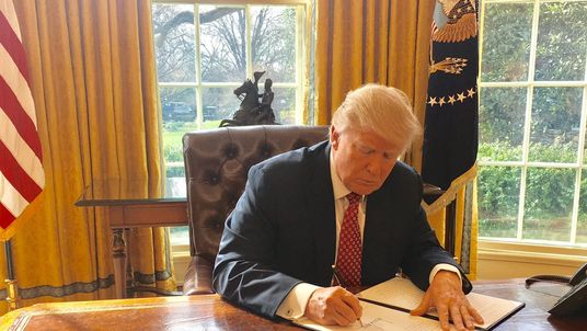 Donald Trump signs his latest executive order restricting travel by citizens of six mainly-Muslim countries.