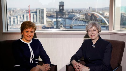 Nicola Sturgeon (L) and Theresa May