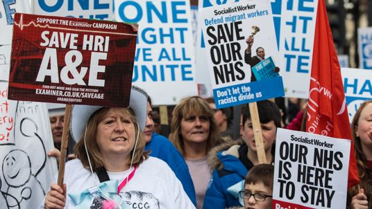 Protesters chant as they hold up placards during a demonstration in support of the NHS in Tavistock Square on March 4, 2017 in London, England. Thousands march from Tavistock Square to Parliament today for a demonstration against hospital closures, privatisation and cuts to the NHS