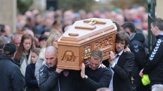 The coffin is carried to its final resting place