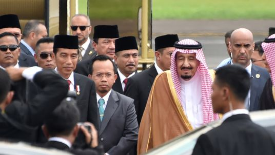 Indonesia's President Joko Widodo (centre L) welcomes Saudi Arabia's King Salman bin Abdul Aziz