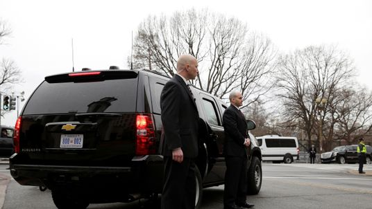 Secret Service agents stand by the Presidential vehicle during Mr Trump's inauguration on 20 January