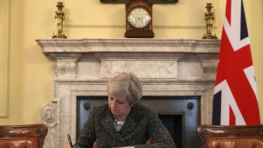 Prime Minister Theresa May in the cabinet signs the Article 50 letter, as she prepares to trigger the start of the UK's formal withdrawal from the EU on Wednesday. Read less