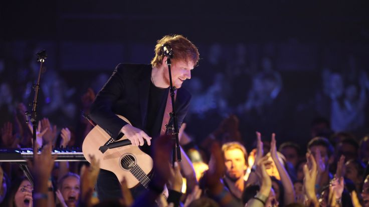 Musician Ed Sheeran performs onstage at the 2017 iHeartRadio Music Awards