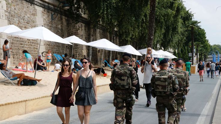 Troops patrol the banks of the Seine in central Paris