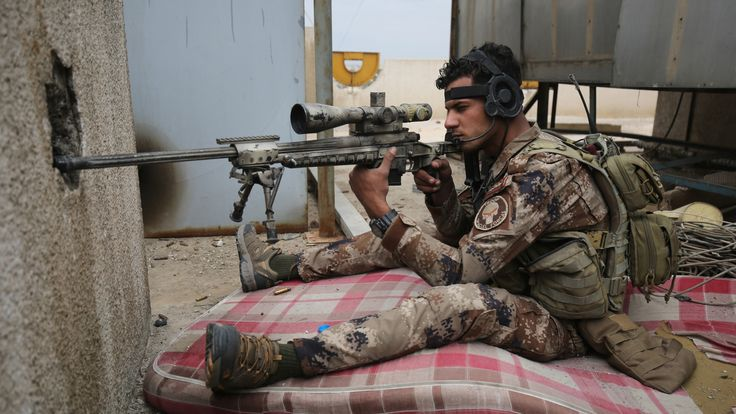 An Iraqi army sniper takes aim during the advance on Mosul's Old City