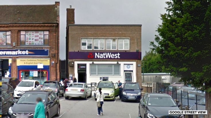 'Armed' man arrested after bank worker 'held hostage'