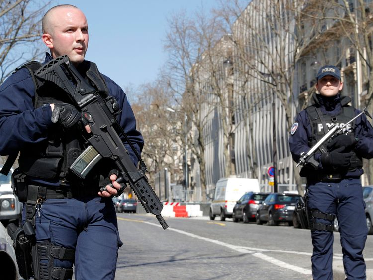 Armed police outside the International Monetary Fund in Paris, where one person has been injured
