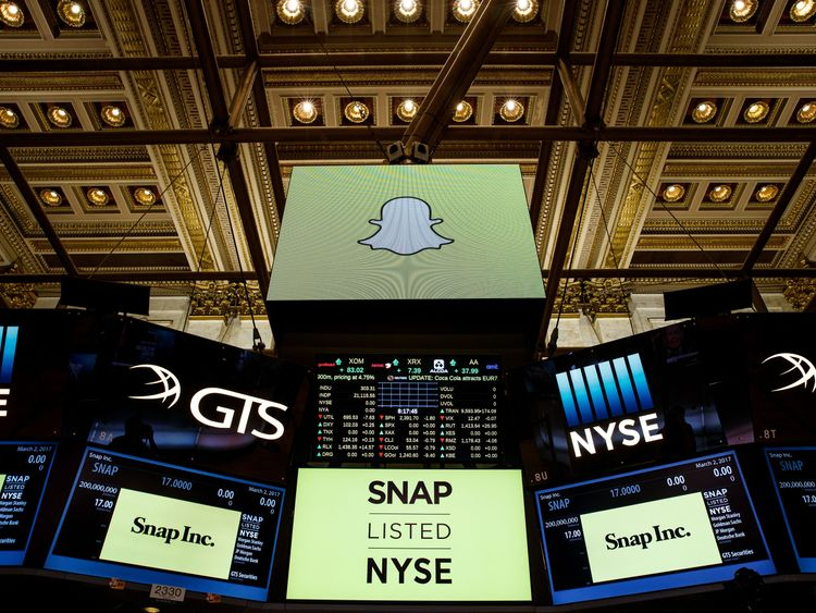 Signage for Snap Inc., parent company of Snapchat, is displayed on monitors on the floor New York Stock Exchange (NYSE) before the opening bell, March 2, 2017 in New York City. Snap Inc. priced its initial public offering at $17 a share on Wednesday and Snap shares will start trading on the New York Stock Exchange on Thursday