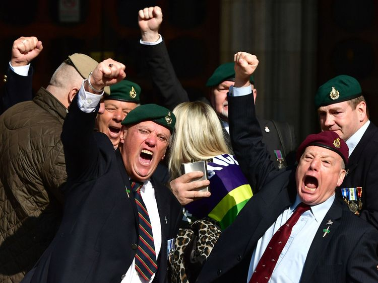 Supporters of Alexander Blackman celebrate outside the Royal Courts of Justice