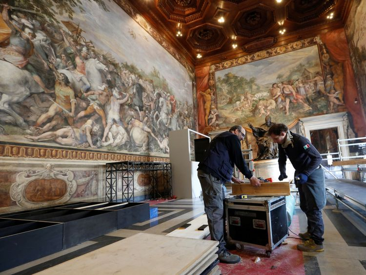 Workers prepare the Orazi and Curiazi hall for the meeting of EU leaders on the 60th anniversary of the Treaty of Rome, in Rome, Italy March 24, 2017. REUTERS/Remo Casilli