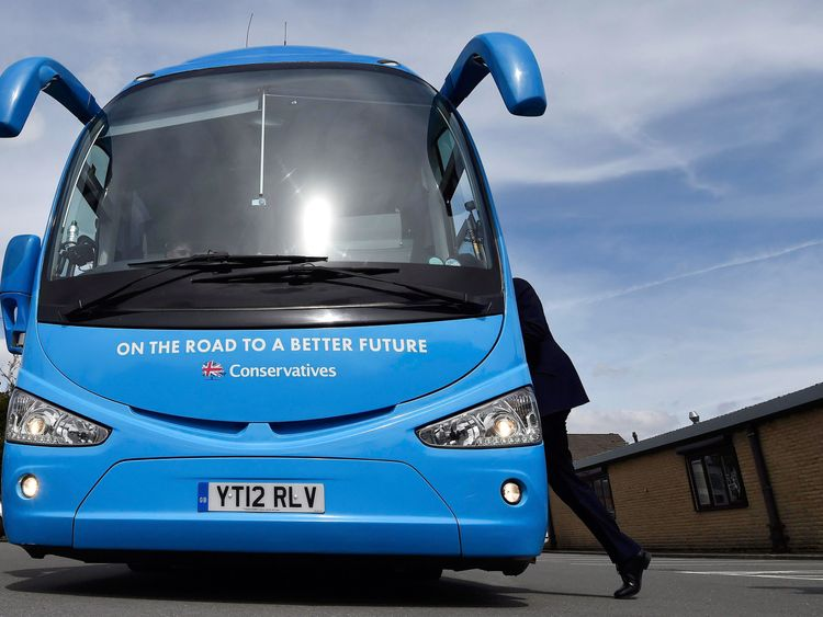David Cameron steps onto the Conservative Party campaign bus in Lancashire during the 2015 general election