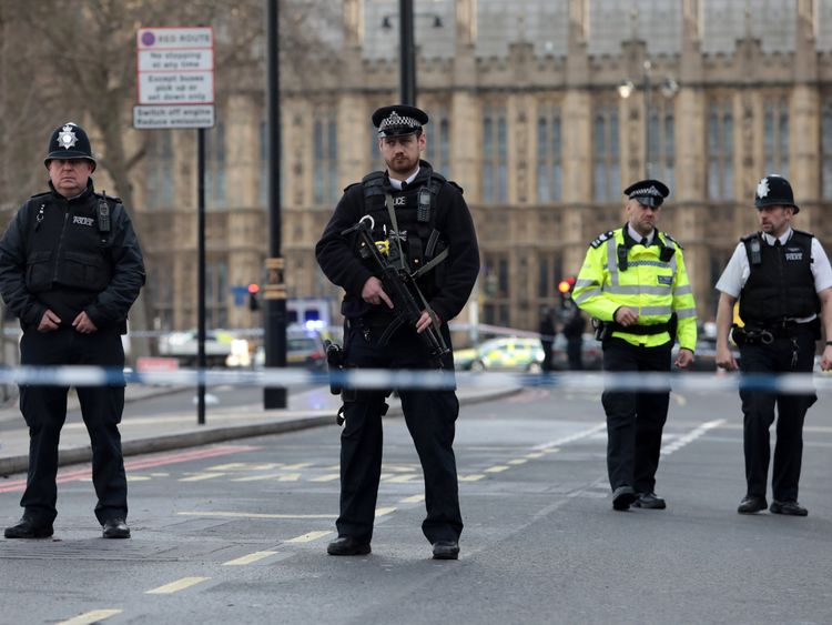Armed officers outside Westminster Bridge following a terror attack in which several people have been killed