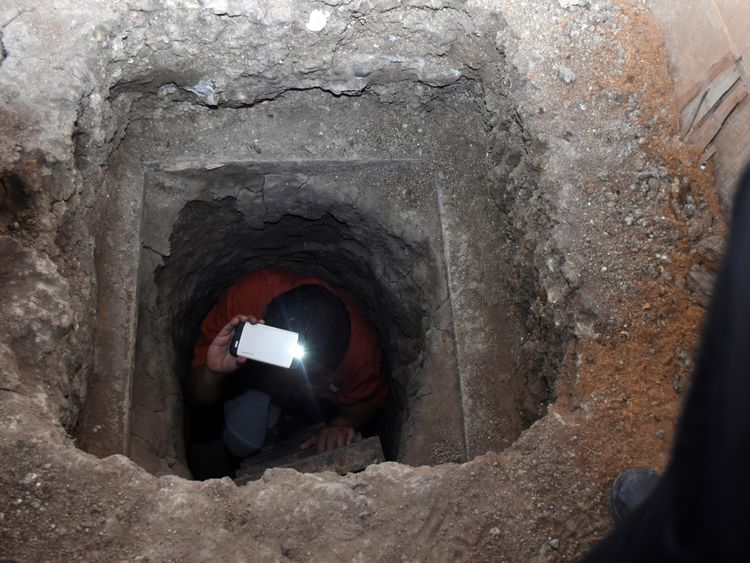 A journalist exits a 40-meter tunnel, through which 29 inmates escaped from a prison, according to local media, in Ciudad Victoria, in Tamaulipas state, Mexico March 24, 2017