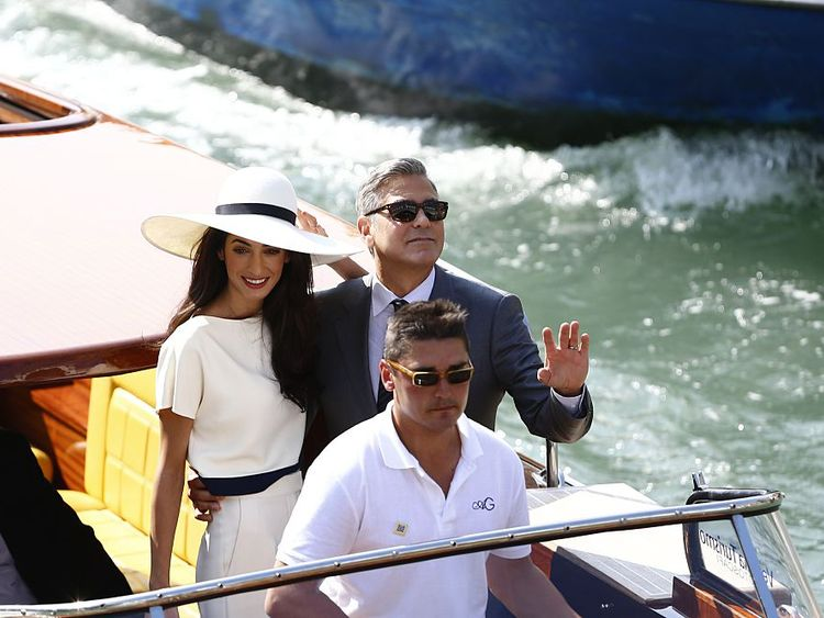 George Clooney and wife Amal took a boat ride under the Rialto Bridge after their wedding in 2014