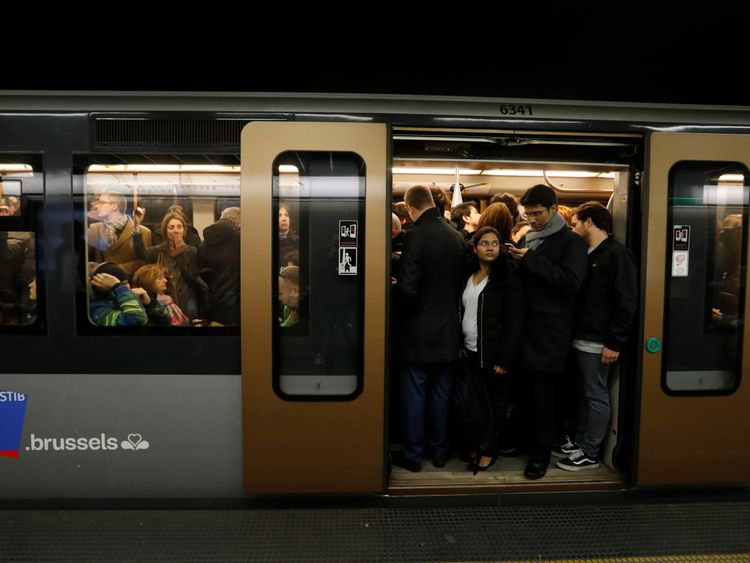 Passengers observe a minute's silence on the Brussels metro