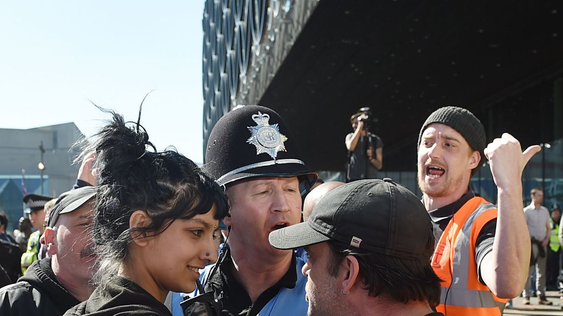 Saffiyah Khan faces down an EDL protester at a demonstration in Birmingham