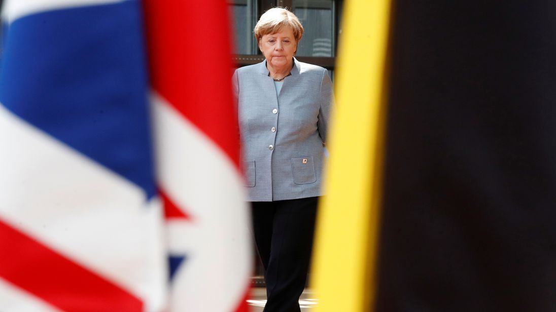 German Chancellor Angela Merkel walks past the Union Jack flag as she arrives at the EU summit in Brussels, Belgium, April 29, 2017