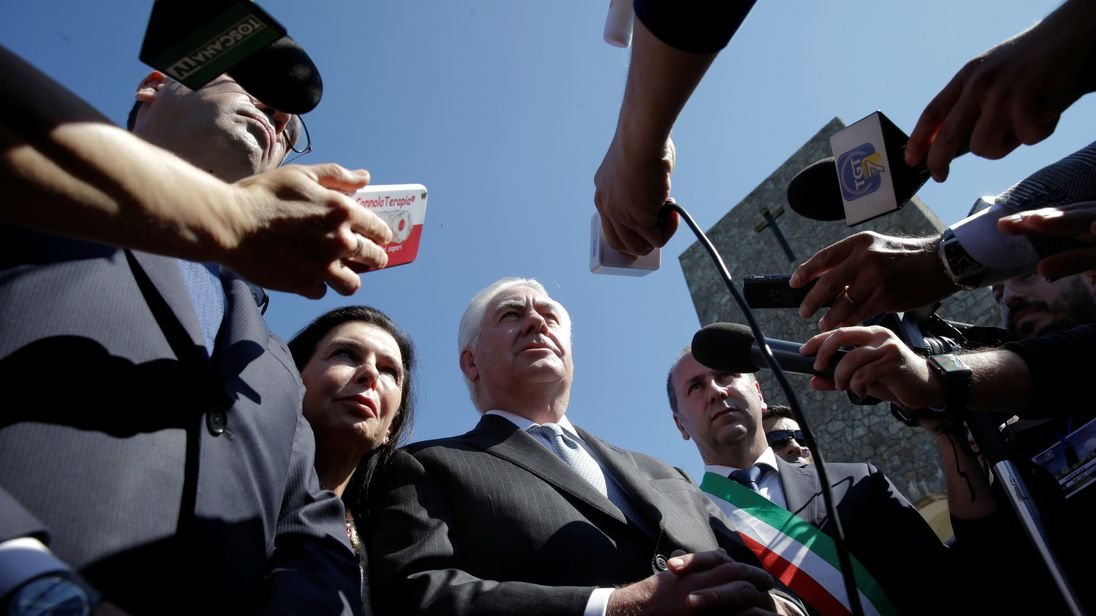 Rex Tillerson talks to reporters during a ceremony at the Sant'Anna di Stazzema memorial in Tuscany