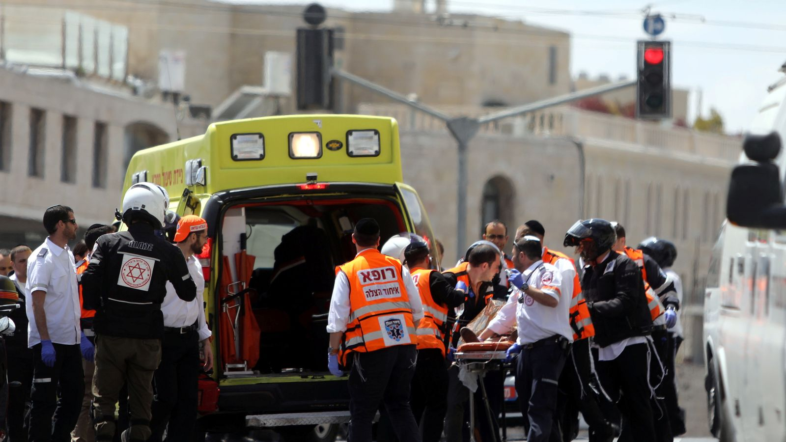 Paramedics treat an injured person following the attack