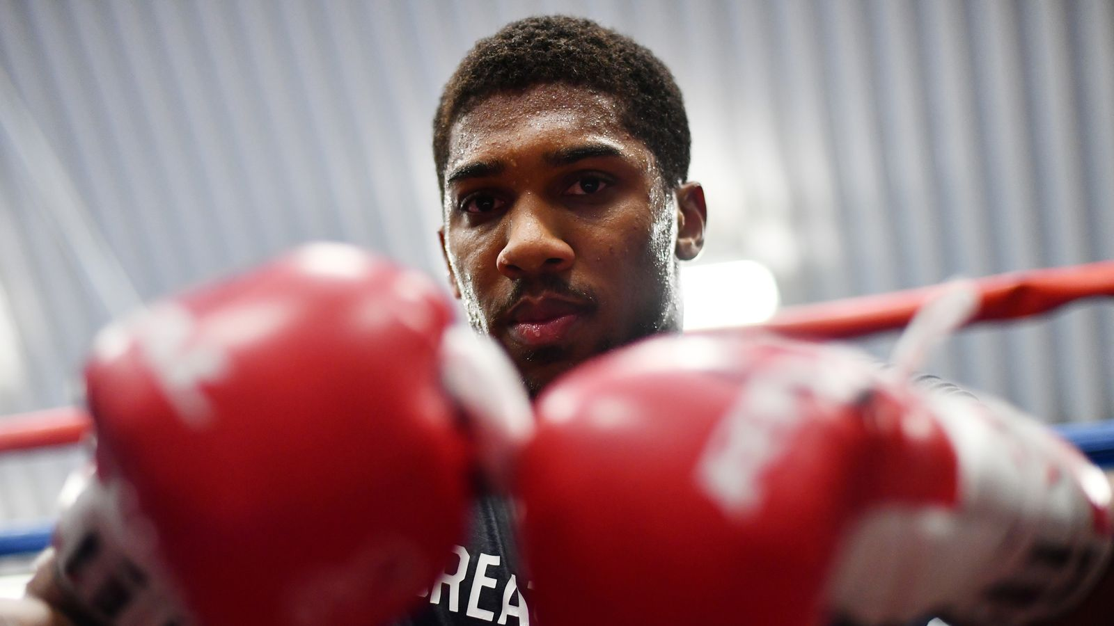 SHEFFIELD, ENGLAND - APRIL 19:  Anthony Joshua looks on during the media workout at EIS Sheffield on April 19, 2017 in Sheffield, England.  (Photo by Dan M