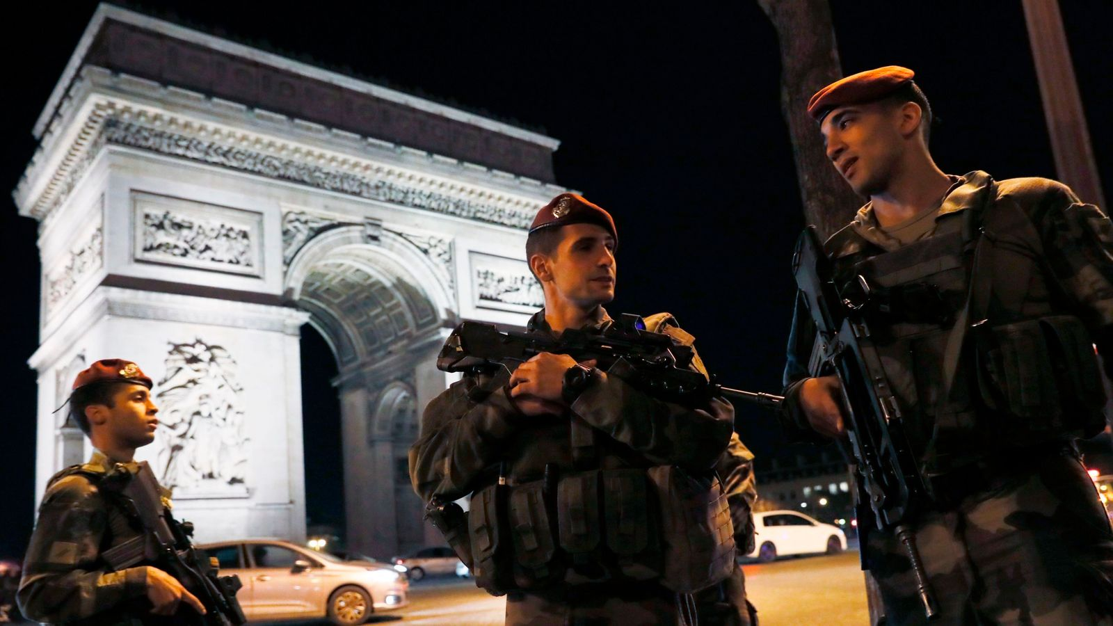 French soldiers stand guard at the Arc de Triomphe near the Champs Elysees in Paris after a shooting on April 20, 2017