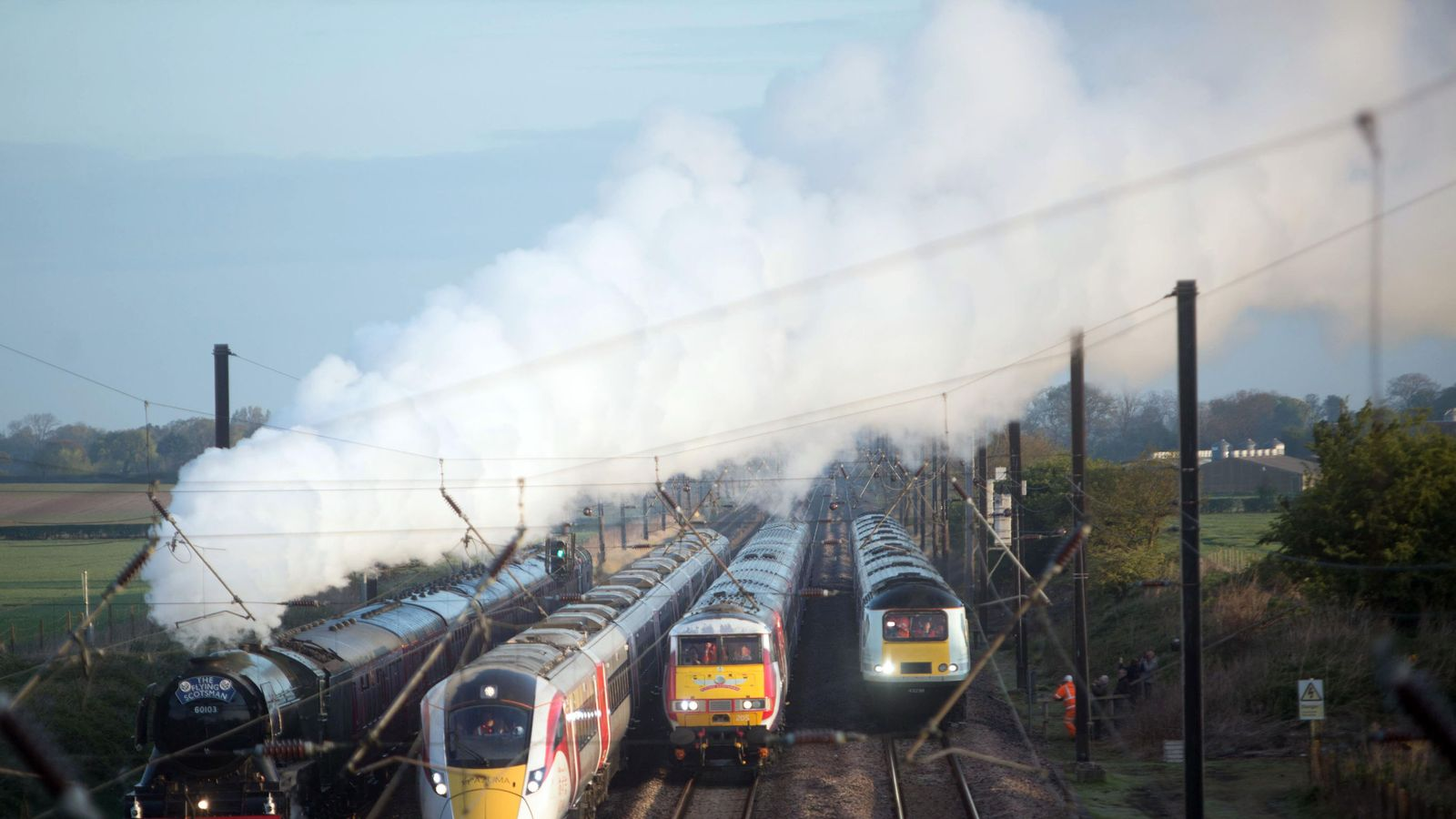 The Flying Scotsman and Virgin Trains' new Azuma travel in the same direction alongside two of the rail operator's present day fleet - to depict the past, present and future of UK rail travel, in a world first