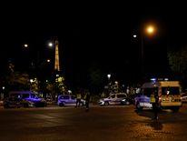 Police vehicles seen near the Eiffel Tower