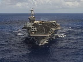 The supercarrier is now headed from Singapore to the Western Pacific Ocean