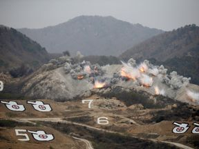 Explosions at targets during U.S.-South Korea joint live-fire military exercise at training field near the DMZ in Pocheon