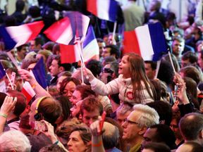 Supporters of founder and Leader of the political movement 'En Marche !' Emmanuel Macron celebrate