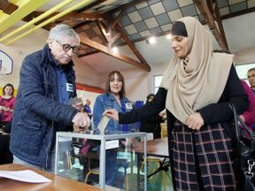 Voters at a polling station in Lyon, France