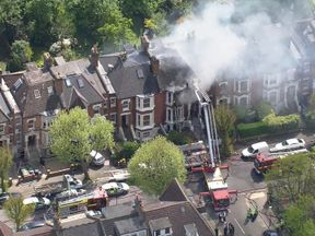 Dozens of firefighters are at the scene of the explosion in north London