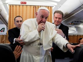 Pope Francis talks to journalists during a press conference on his return flight from Cairo to Rome April 29, 2017
