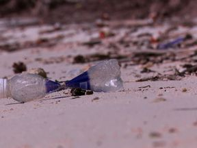 A plastic bottle litters a beach on the Cocos Keeling Islands