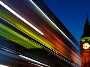 Light trails shine from a passing bus in front of Big Ben and the Houses of Parliament in London, November 17, 2011