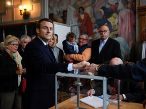 Emmanuel Macron at a polling station in Le Touquet in northern France