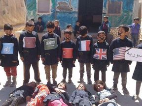 """Children of Idlib, in response to the chemical attack, each representing a state with mouths wide shut, and a sign that says """"friends of Syria"""". Pic: Rami Jarrah"""
